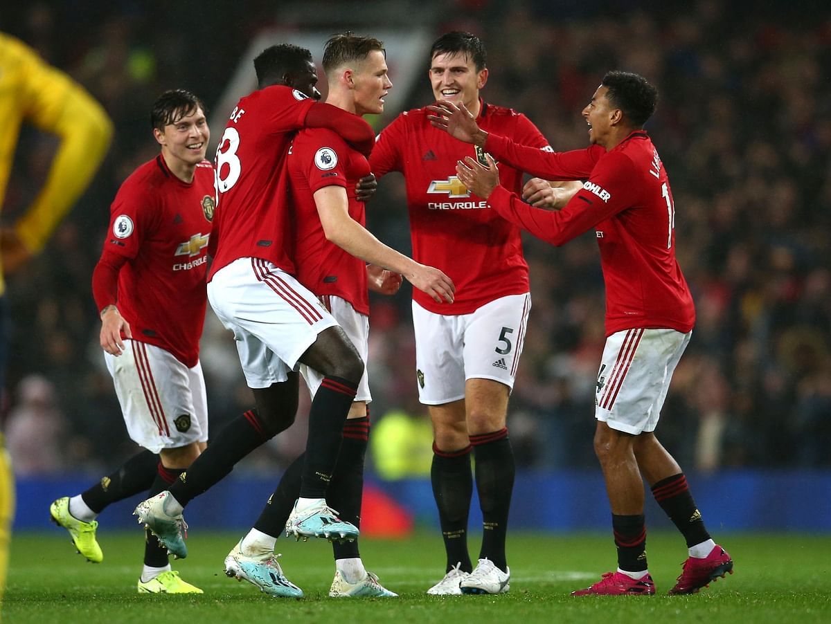 Manchester United players celebrate after Manchester United's Scott McTominay, centre, scored his side's opening goal.