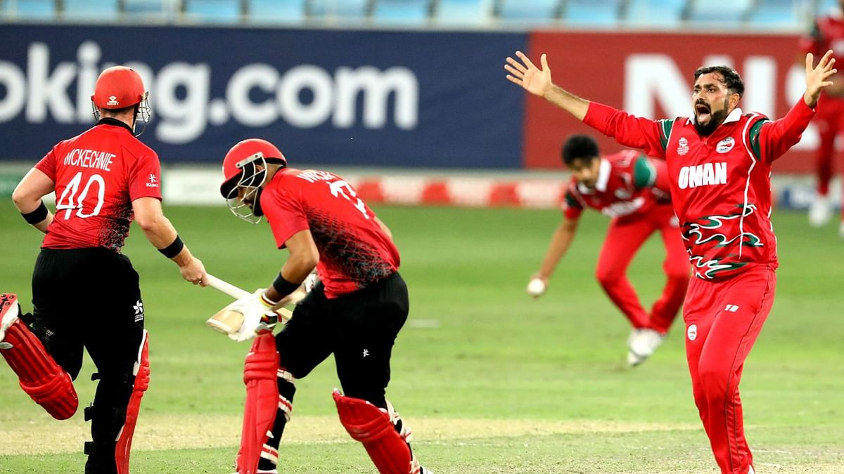 Oman defeated Hong Kong by just 12 runs in a do-or-die T20 World Cup qualifier to reach the finals in Australia.