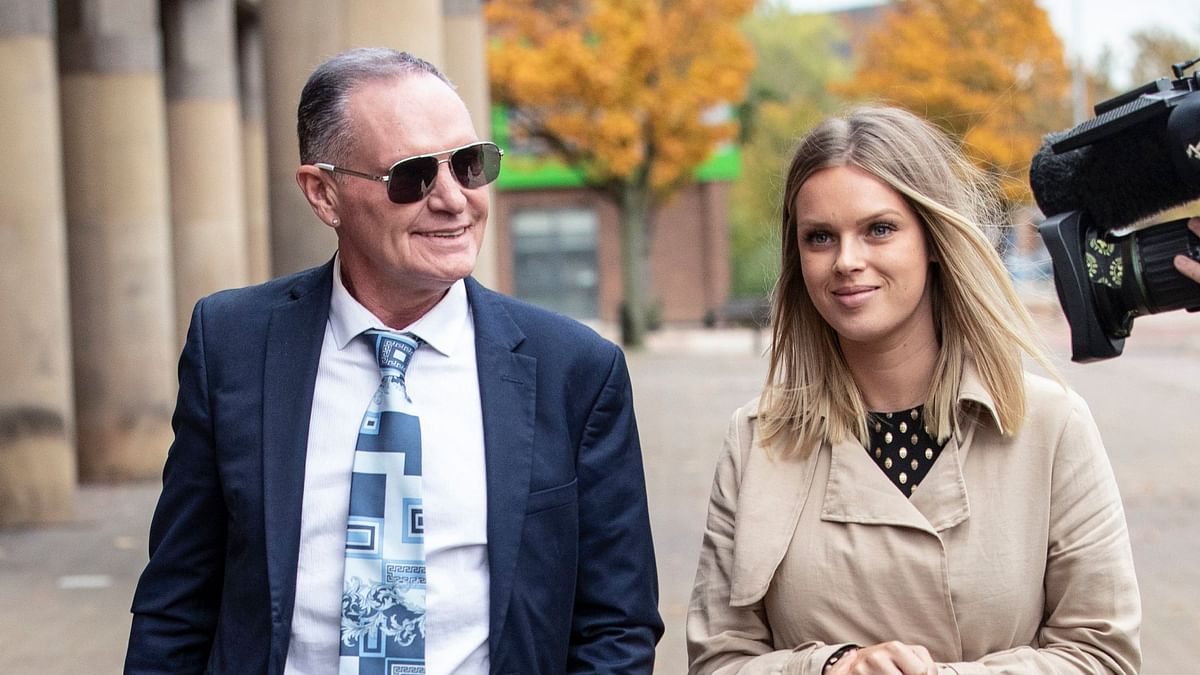 Former soccer player Paul Gascoigne leaves court, accompanied by unidentified woman, after giving evidence on the 2nd day of his trial on charges of alleged sexual assault on a train, in Middlesbrough, England, Tuesday Oct. 15, 2019.