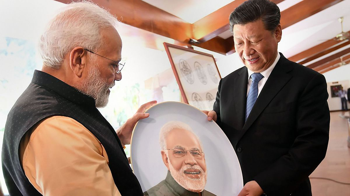 Prime Minister Narendra Modi and Chinese President Xi Jinping exchange gifts at Mamallapuram.