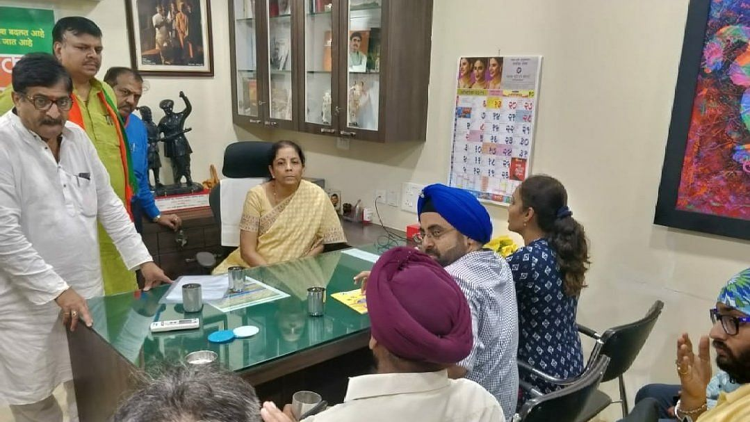 PMC Bank Scam: Sitharaman Faces Protesters, Promises Legislation