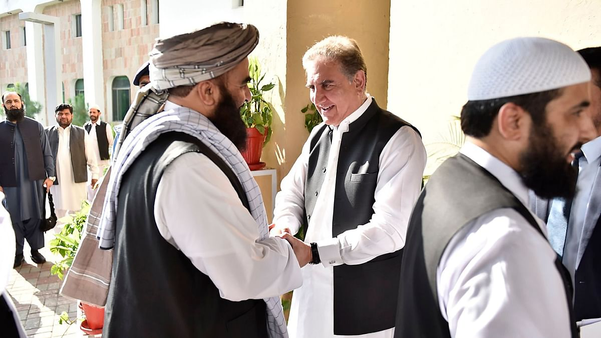 Pakistan's Foreign Minister Shah Mehmood Qureshi, receives members of Taliban delegation at the Foreign Office in Islamabad, Pakistan.