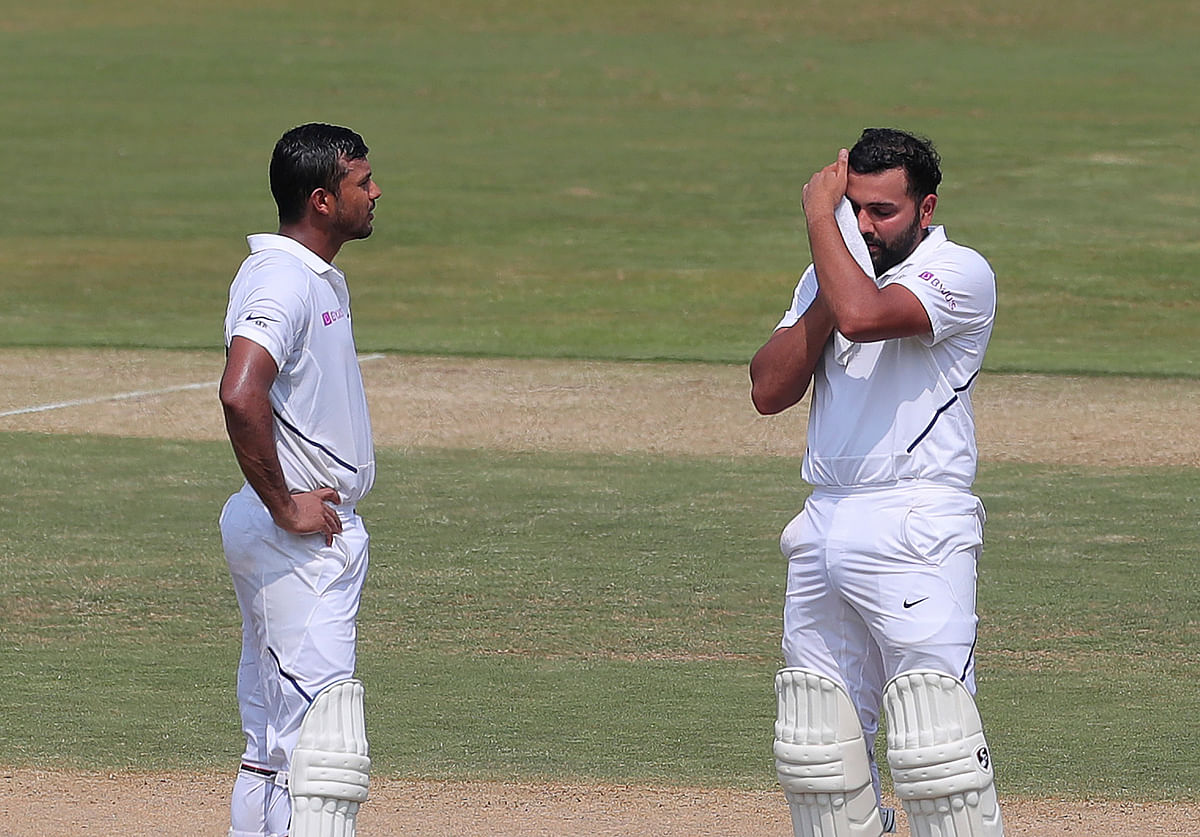 Mayank Agarwal and Rohit Sharma take a break during their 317-run stand on Day 2 of the Vizag Test.