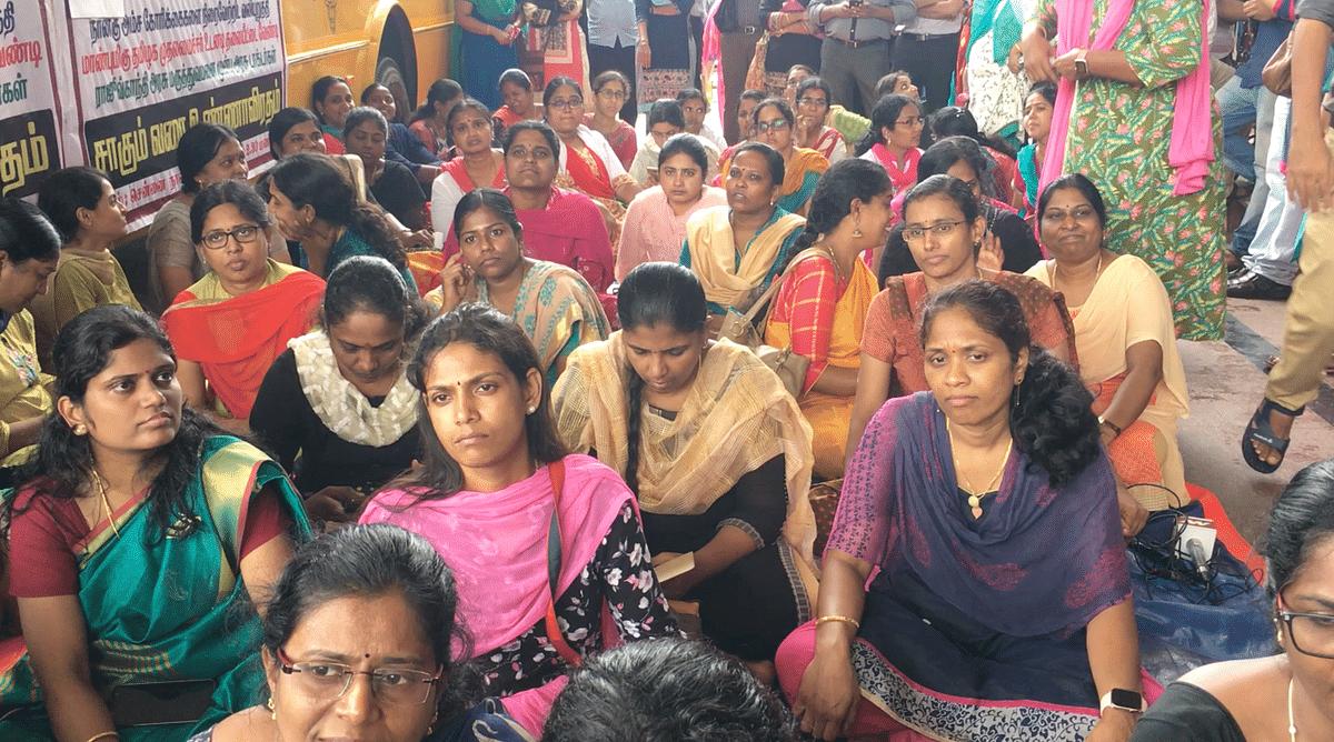 Women doctors sitting in protest outside Rajiv Gandhi Government Hospital.