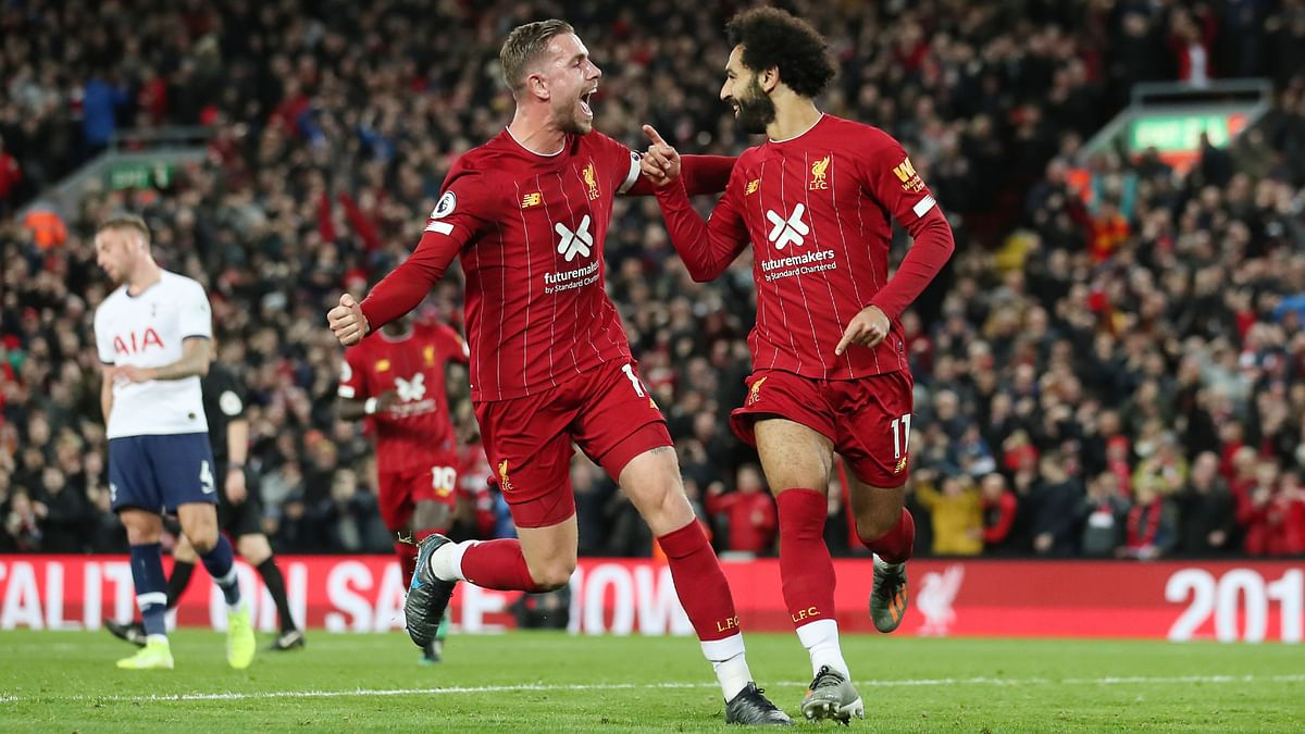 Liverpool captain Jordan Henderson (left) volleyed in the equaliser seven minutes into the second half.