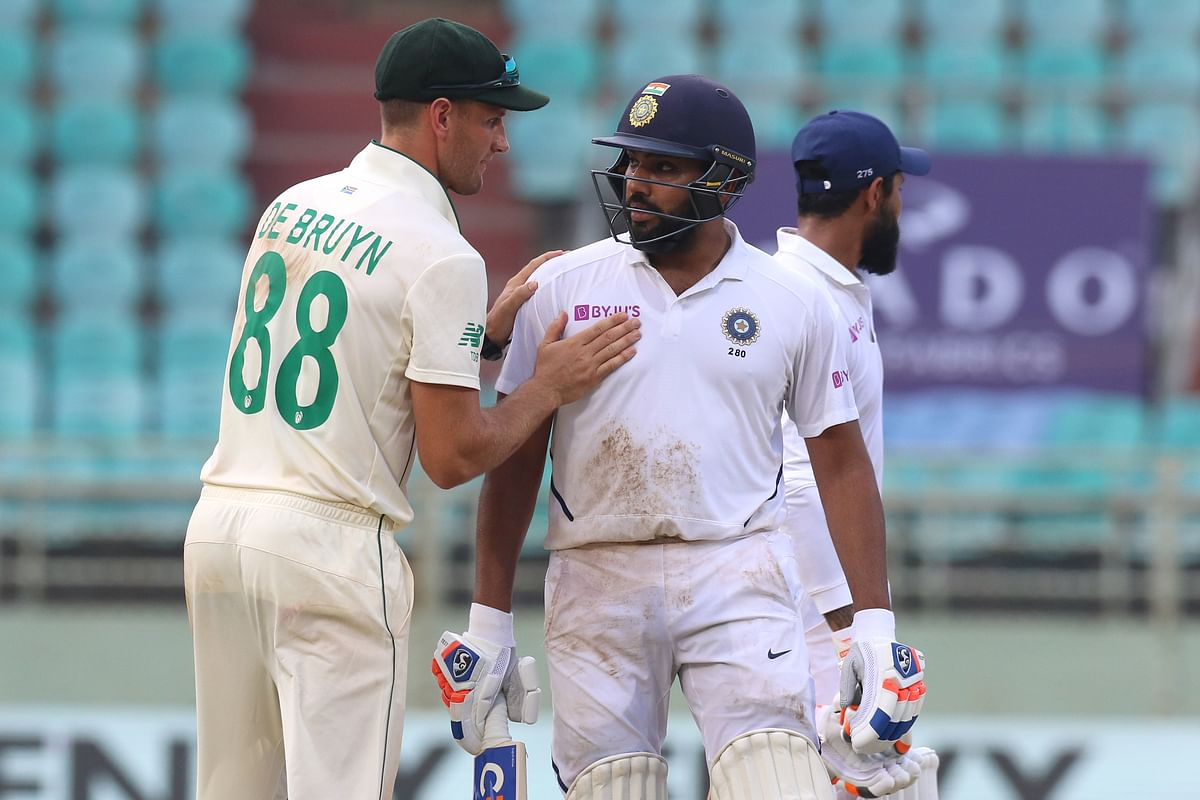 Rohit Sharma of India  being congratulated by Theunis de Bruyn of South Africa for his 100+ runs during day 4 of the first test match between India and South Africa held at the ACA-VDCA Stadium, Visakhapatnam.