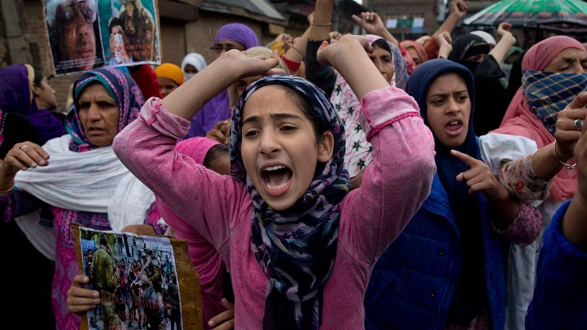 Kashmiris shout slogans during a protest after Friday prayers against the abrogation of article 370, on the outskirts of Srinagar, Oct. 4, 2019. Image used for representation.