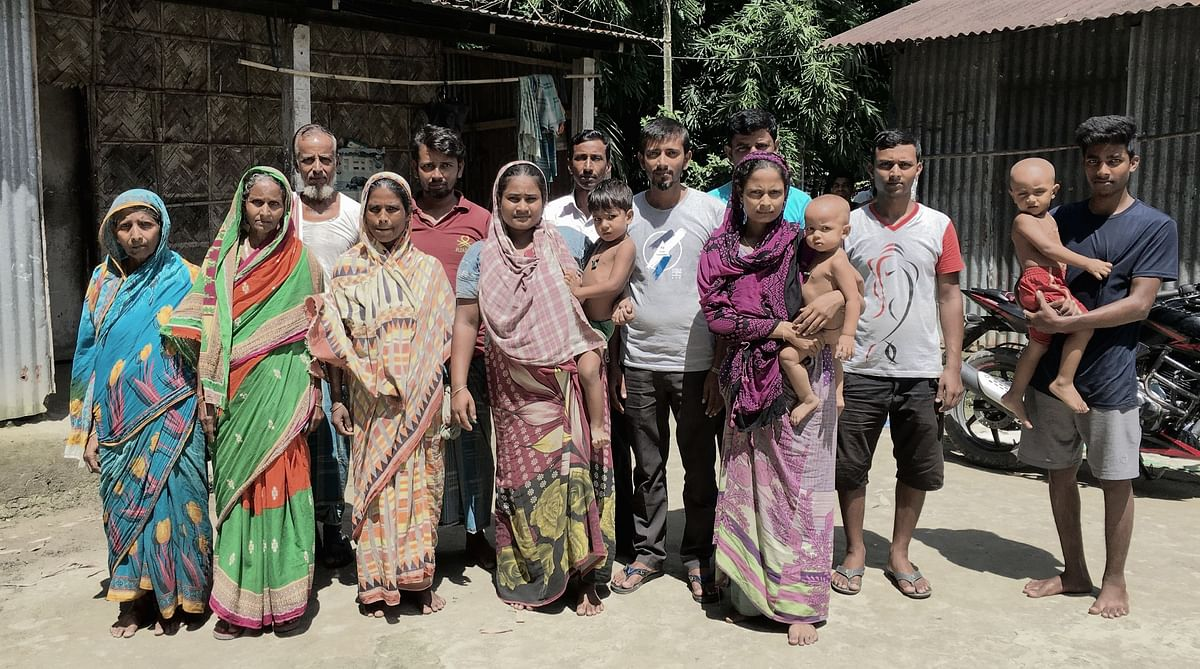 Shahjahan (grey t-shirt in centre) has been helping the poor and illiterate in their NRC documentation.