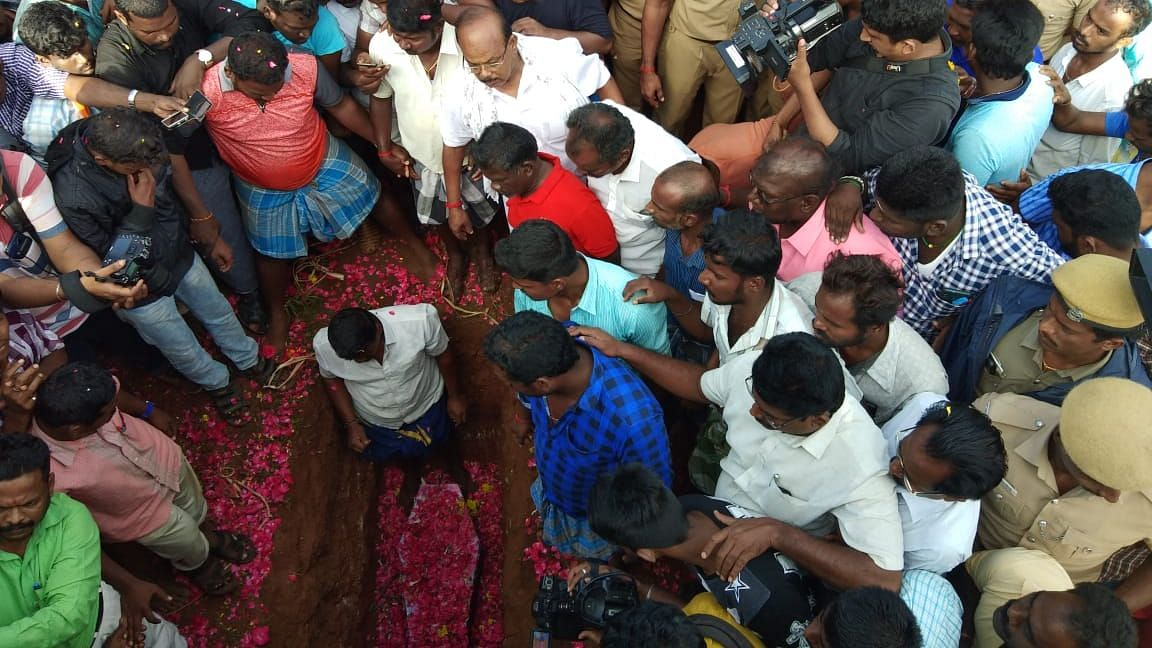 Hundreds gather for Sujith's burial after eight hours of effort to bring him out a borewell failed.