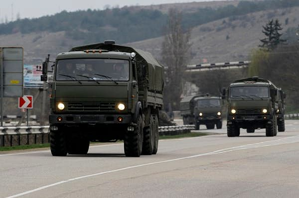 In 2014, Russian troops like those shown here in trucks annexed Ukraine's Crimean peninsula
