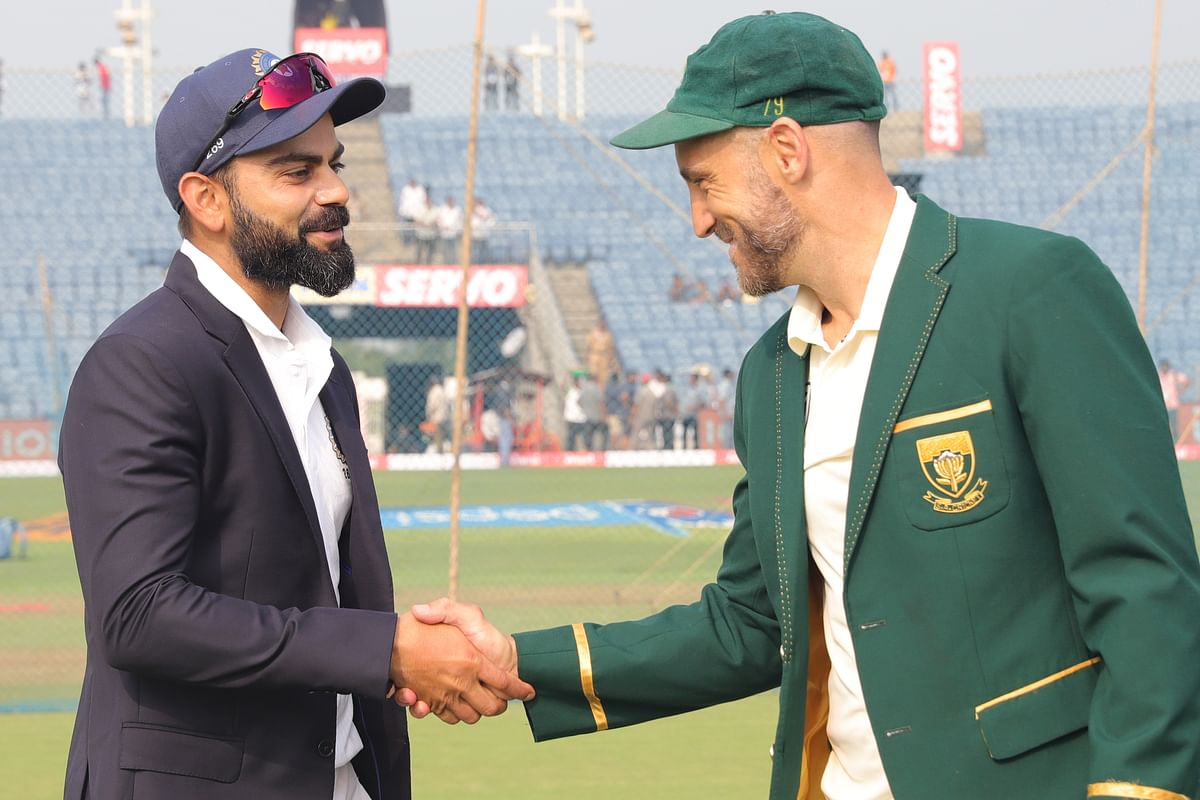 Virat Kohli (captain) of India and Faf du Plessis (c) of South Africa during Toss on the day 1 of the second test match between India and South Africa.