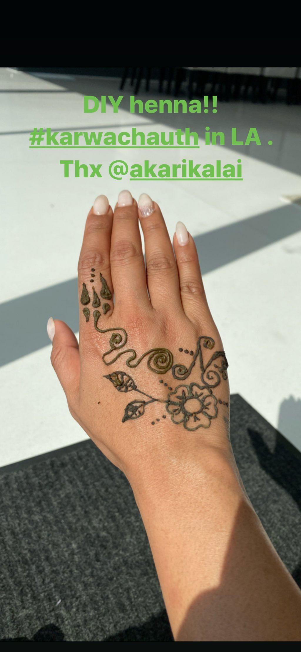 Priyanka applies henna.