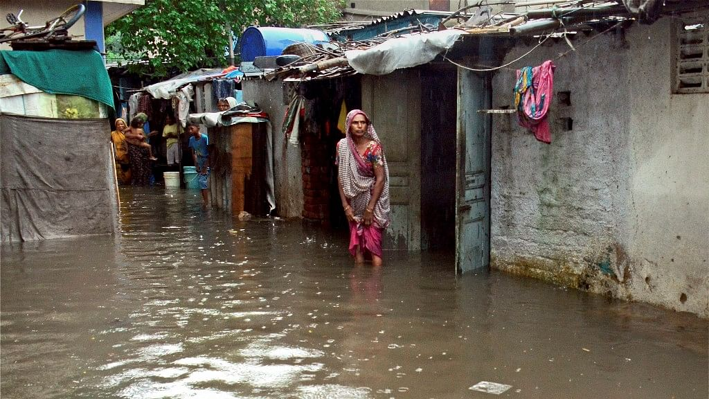 Water-logged houses at a slum area after heavy monsoon rains.