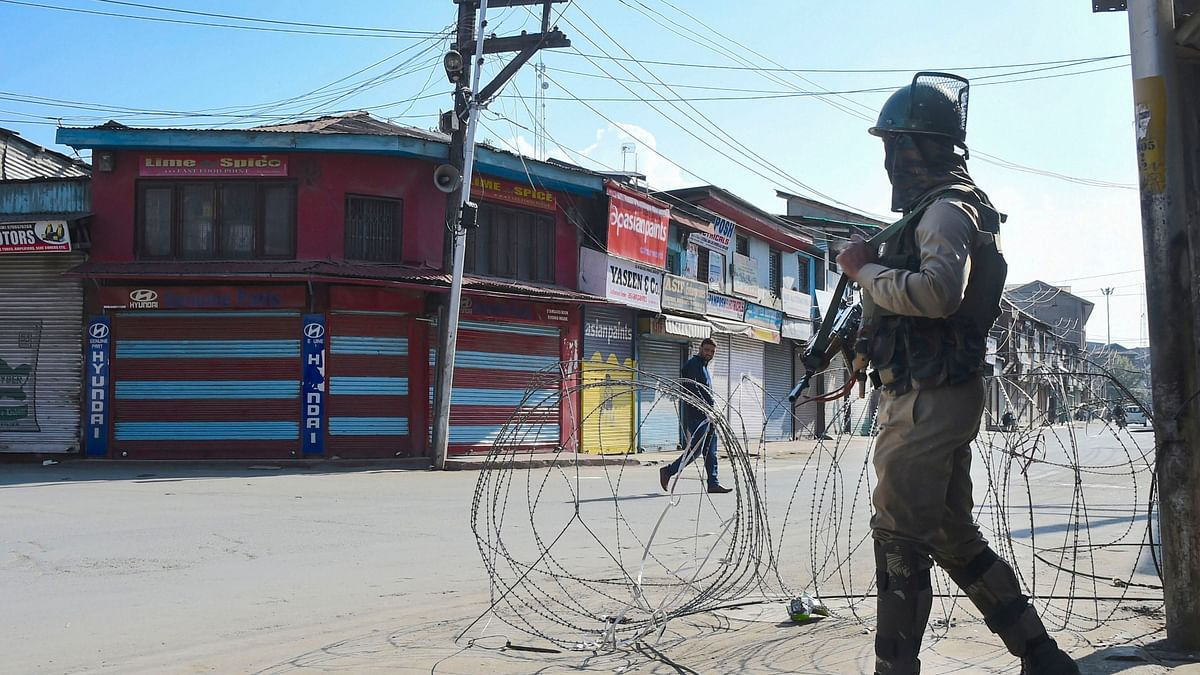 A security personnel stands guard during restrictions, in Srinagar.