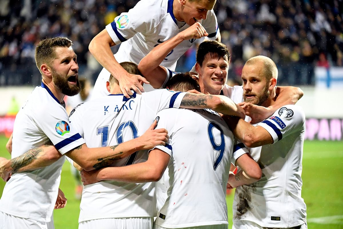 Players of Finland celebrate Fredrik Jensen's first goal of the game against Armenia, during their Euro 2020 group J qualifying soccer match in Turku, Finland, Tuesday Oct. 15, 2019.