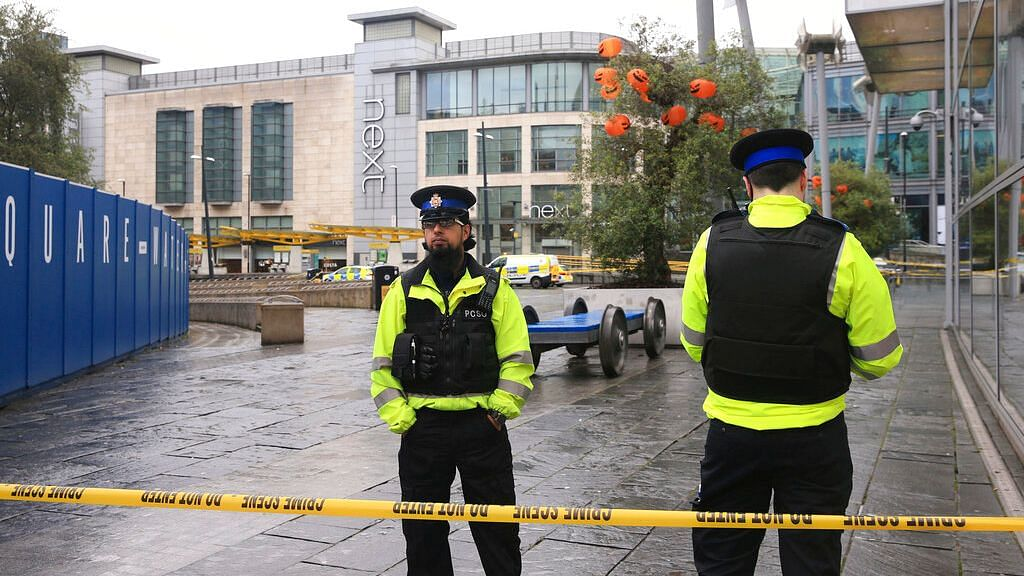 Police outside the Arndale Centre in Manchester, England, Friday 11 October, 2019, after a stabbing incident at the shopping center that left five people injured.