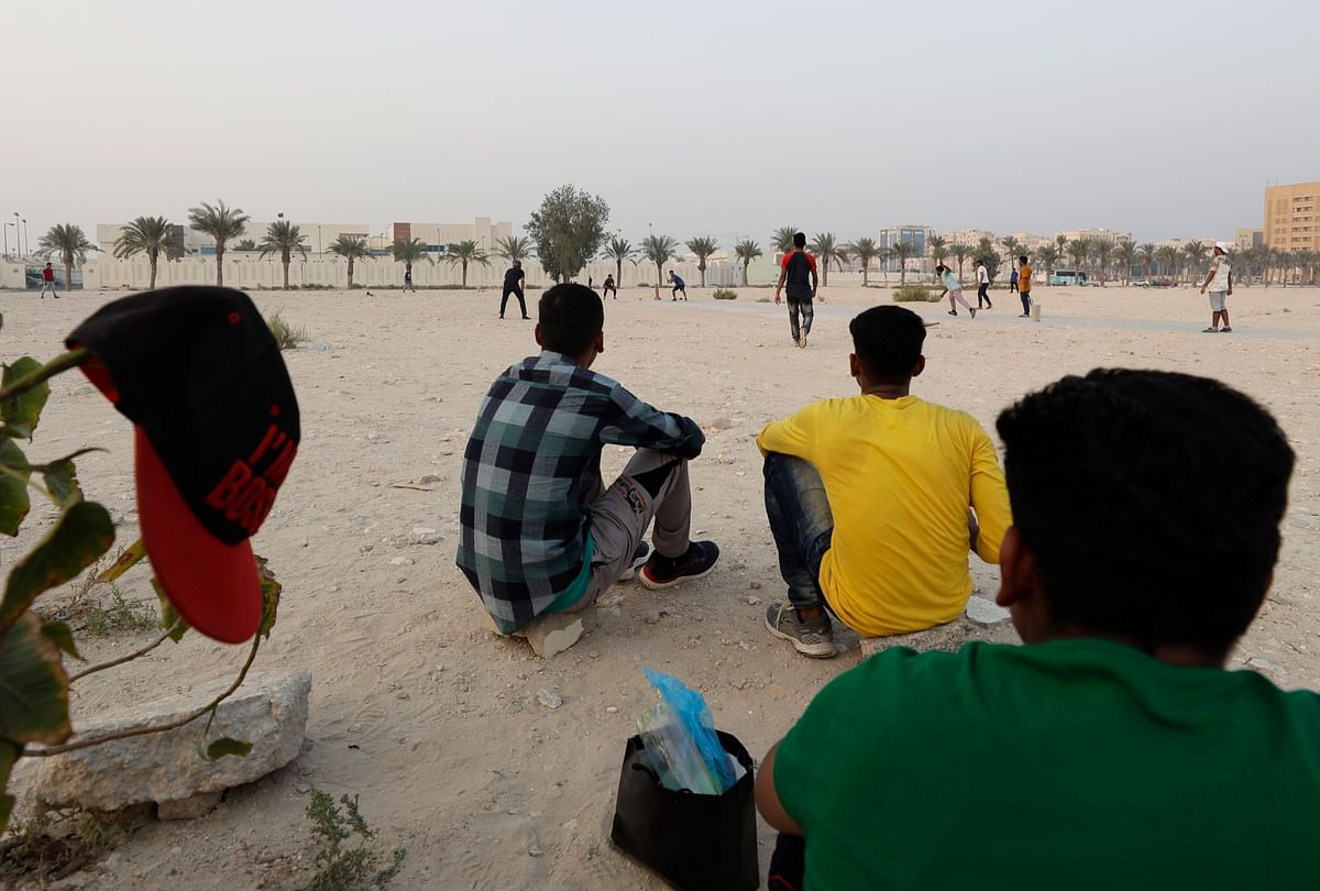 People play cricket on a patch of wasteland in Doha, Qatar, Friday, Oct. 4, 2019. The most played sport in Qatar is nowhere near the country's glitzy, air-conditioned stadiums.