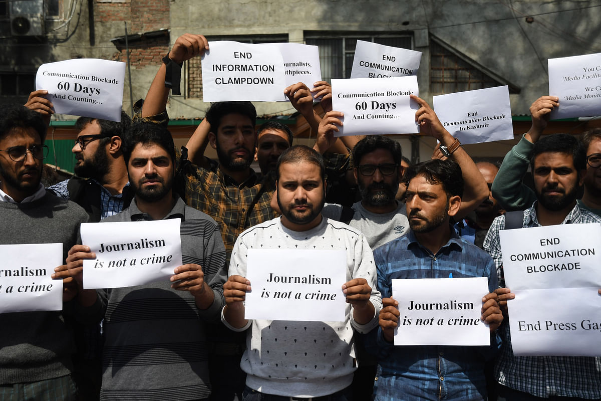 Kashmiri journalists stage silent protest against communication blockade in Kashmir.