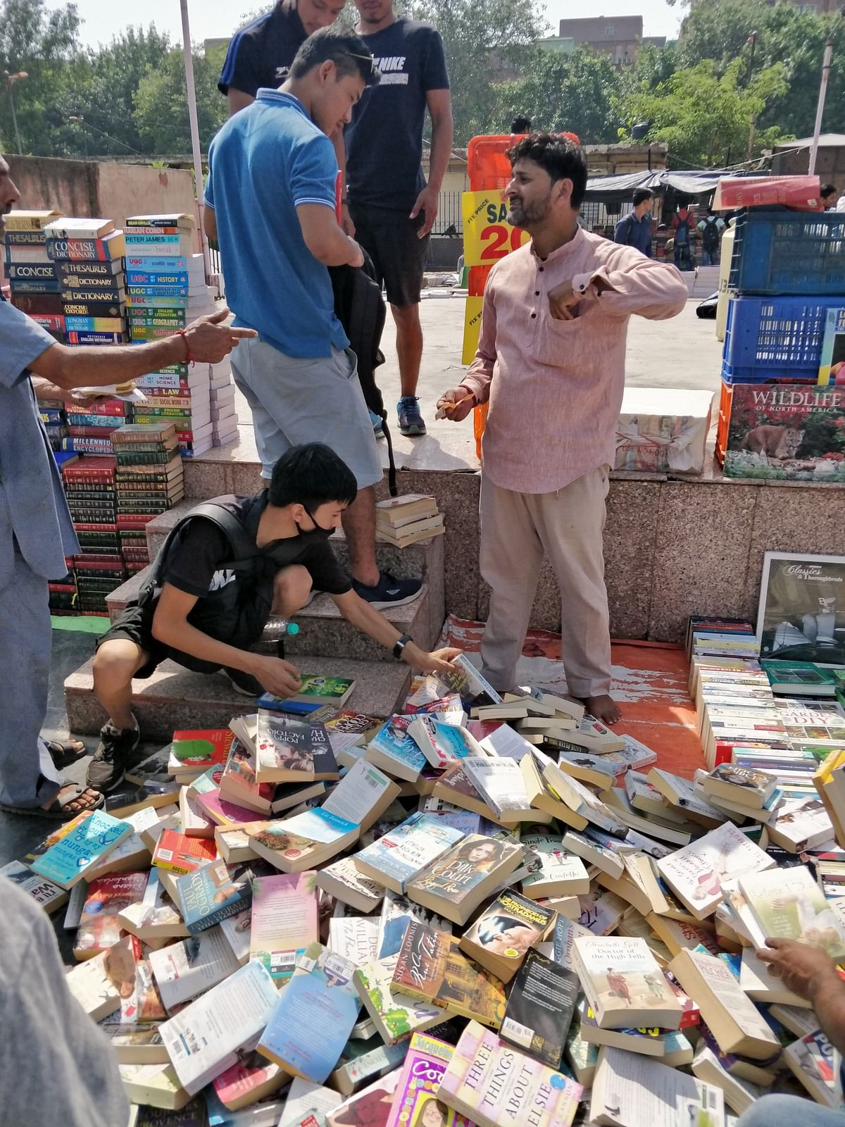 Shopkeepers had displayed all the books in the open under the scorching sun.