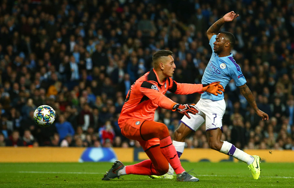 Manchester City's Raheem Sterling, right, scores his side's fifth goal, during the group C Champions League soccer match between Manchester City and Atalanta at the Etihad Stadium in Manchester, England, Tuesday, Oct. 22, 2019.