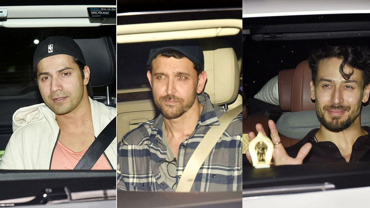 Varun Dhawan, Hrithik Roshan and Tiger Shroff at the special screening of <i>War</i>.