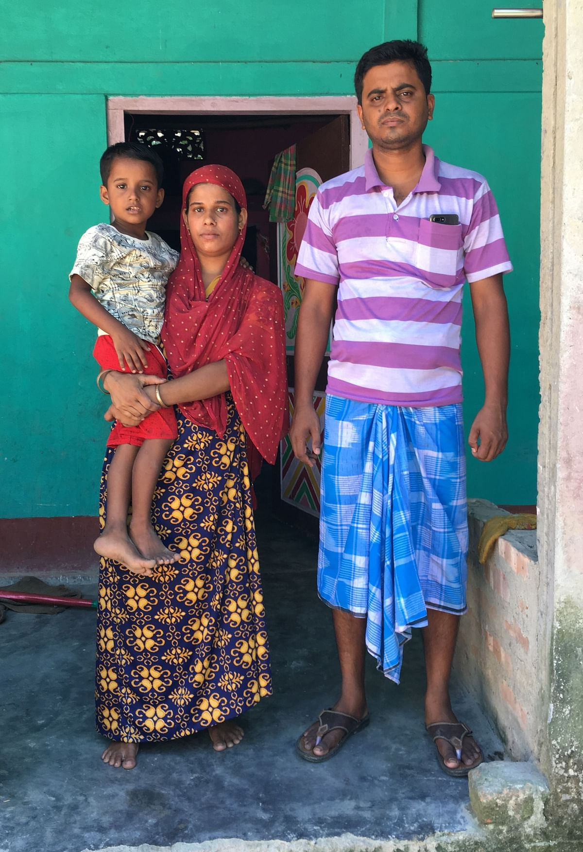Saahin Ashwar with his parents at his house in Baksa in Assam.