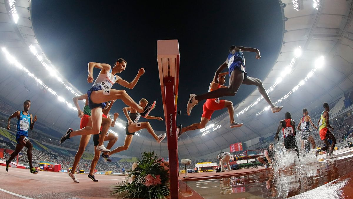 Runners compete in a men's 3000 meter steeplechase heat at the World Athletics Championships in Doha, Qatar, Tuesday, Oct. 1, 2019.