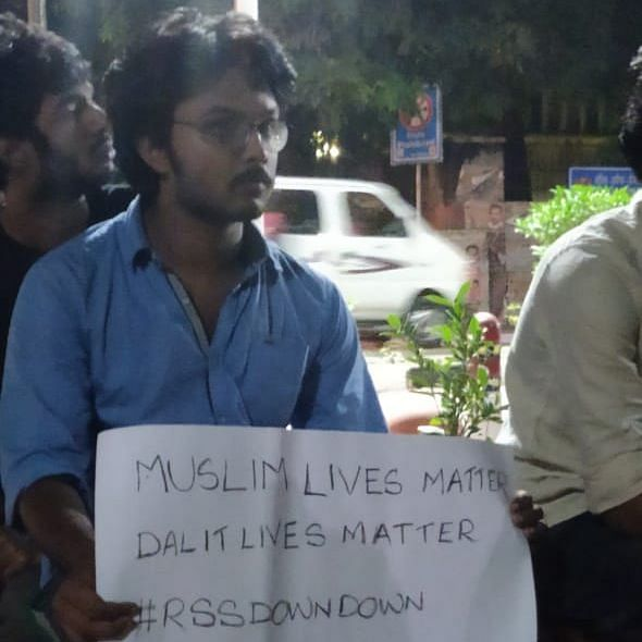 Noel Benny, a student of the Zakir Hussain College participating in protests outside DU's Arts Faculty.
