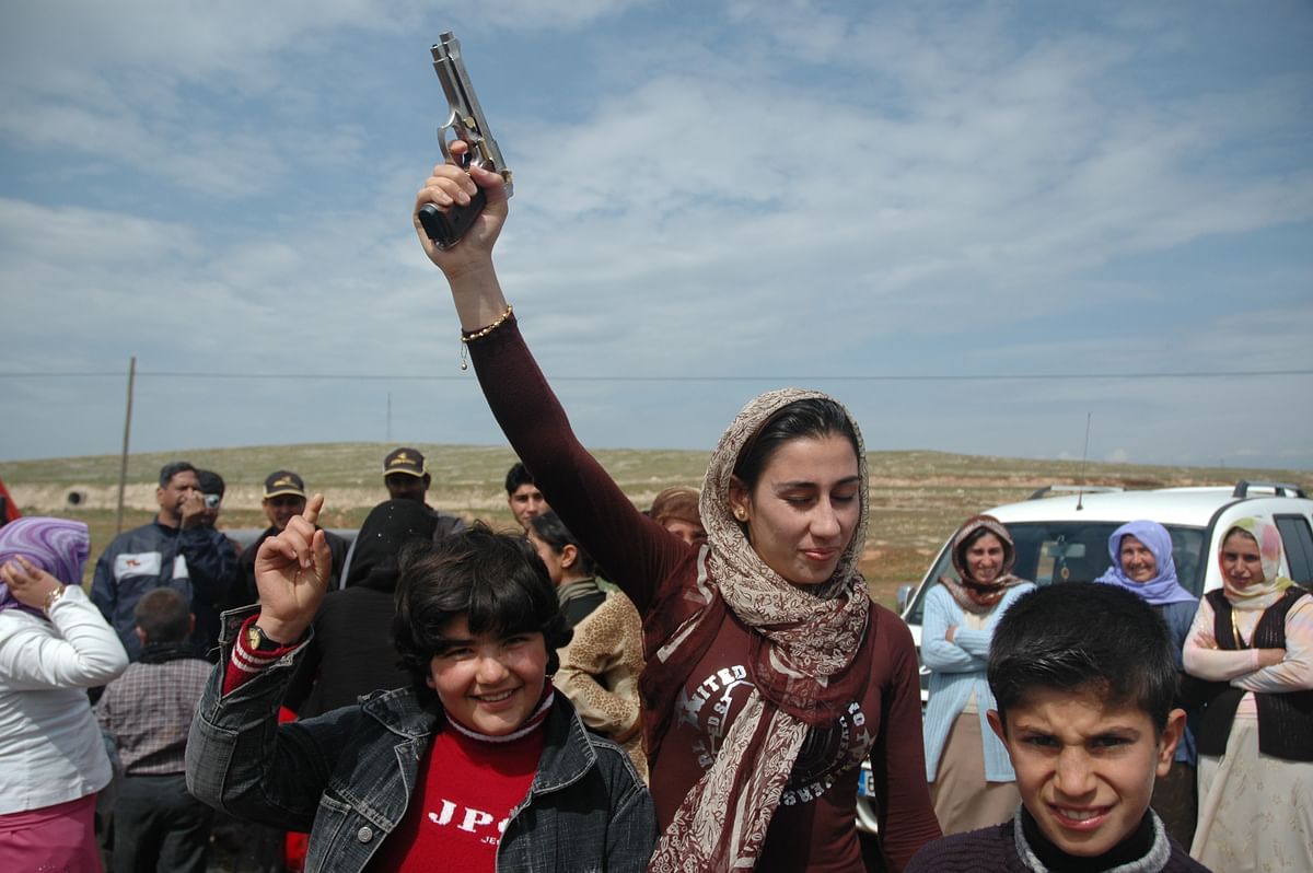 At the wedding, men, women and children fired in the air with their arsenal of 12-bore shotguns and pistols, shouting pro-Kurdistan slogans.