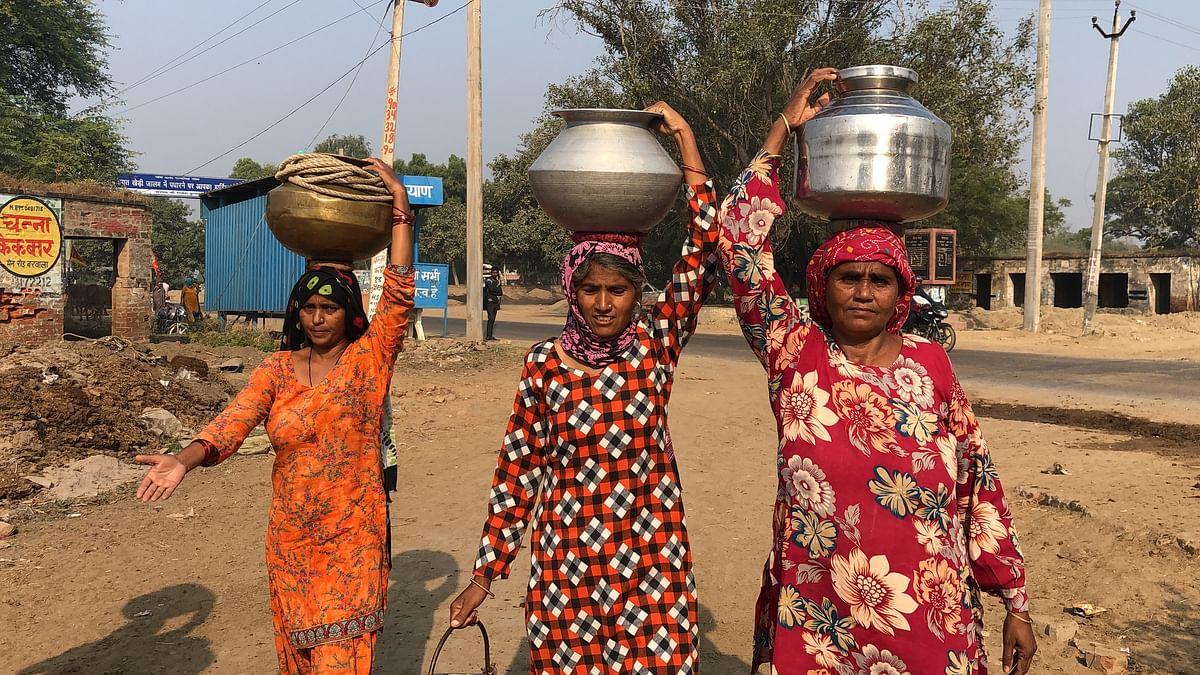 Women fetch water in Kheri Chopta village in Hisar.