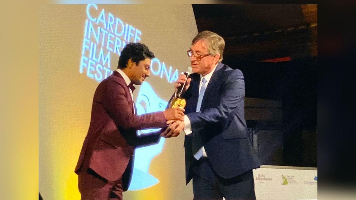 Nawazuddin Siddiqui accepts the Golden Dragon at the Cardiff International Film Festival.
