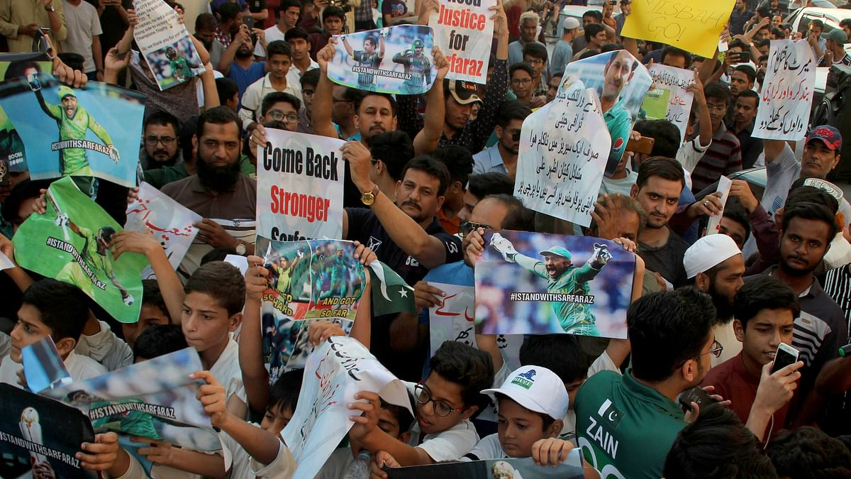Dozens of people have protested the firing of Sarfaraz Ahmed as captain of Pakistan's Test and Twenty20 cricket teams.