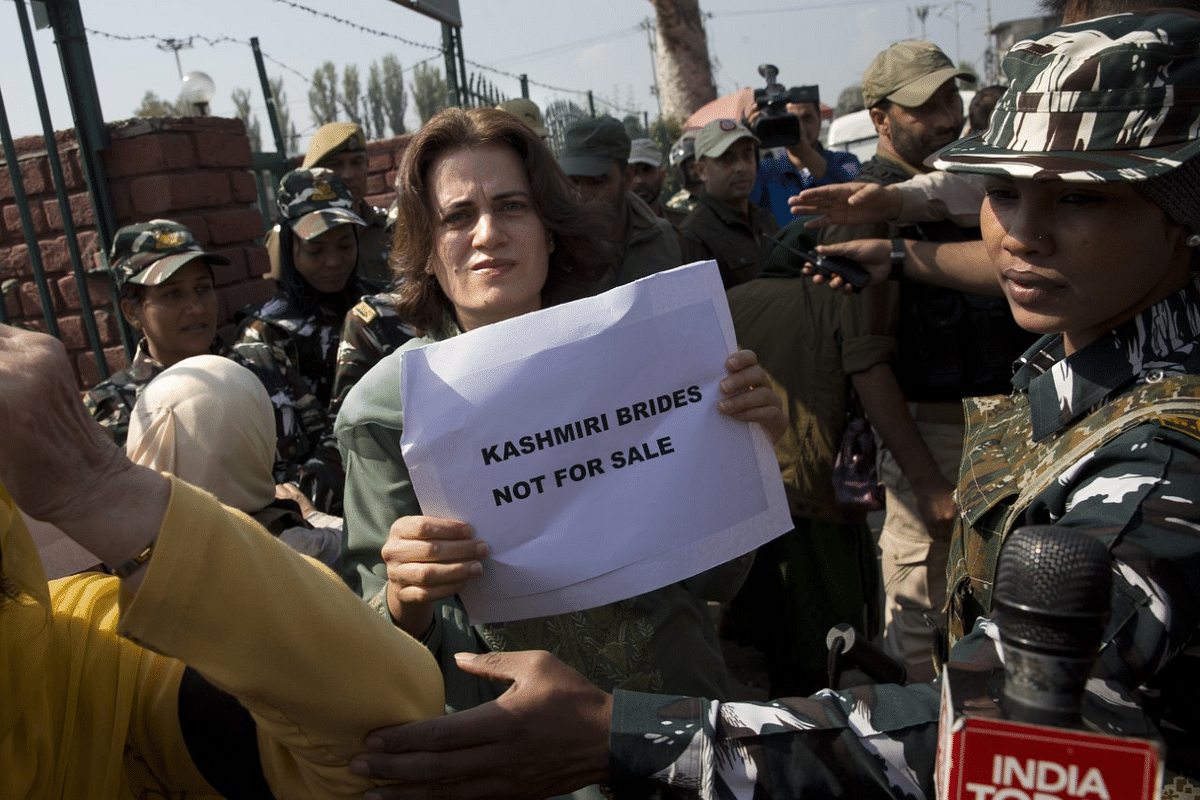 Safia Abdullah, daughter of Jammu and Kashmir National Conference leader Farooq Abdullah, holds a placard during a protest in Srinagar.