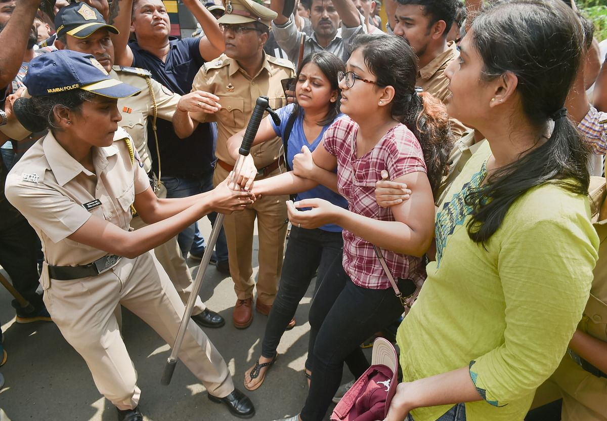 Police detain citizens who were staging a protest against the tree-cutting at Aarey.