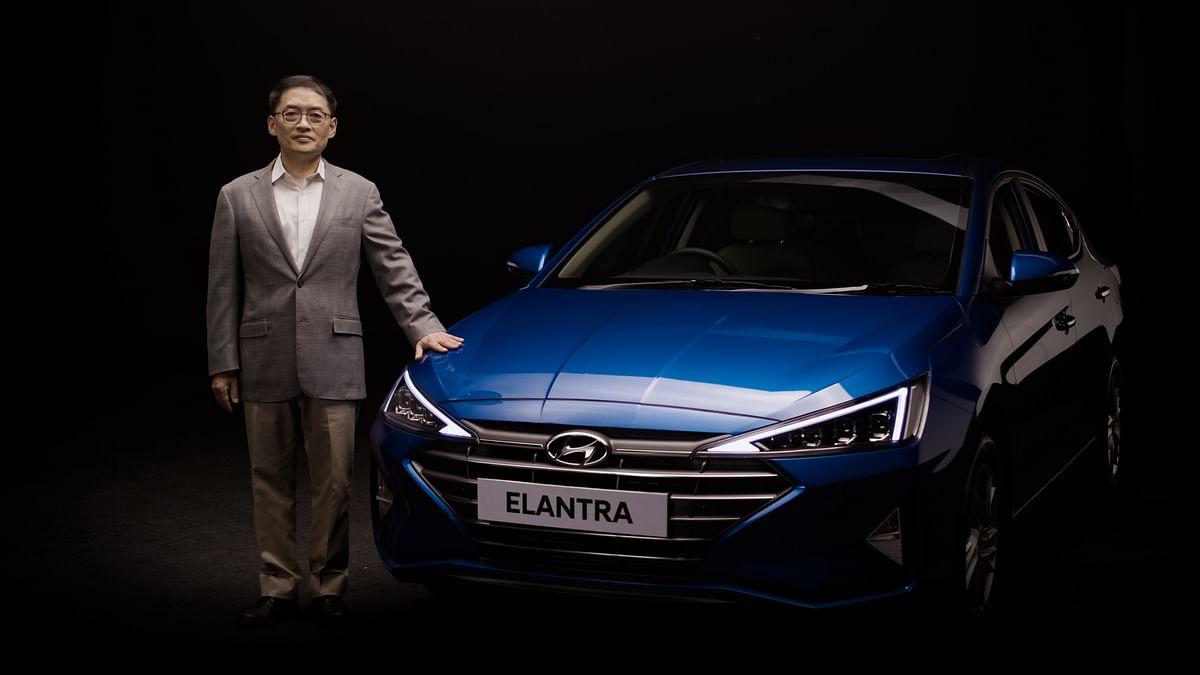 The new 2019 Hyundai Elantra along with SS Kim, MD & CEO Hyundai Motor India.