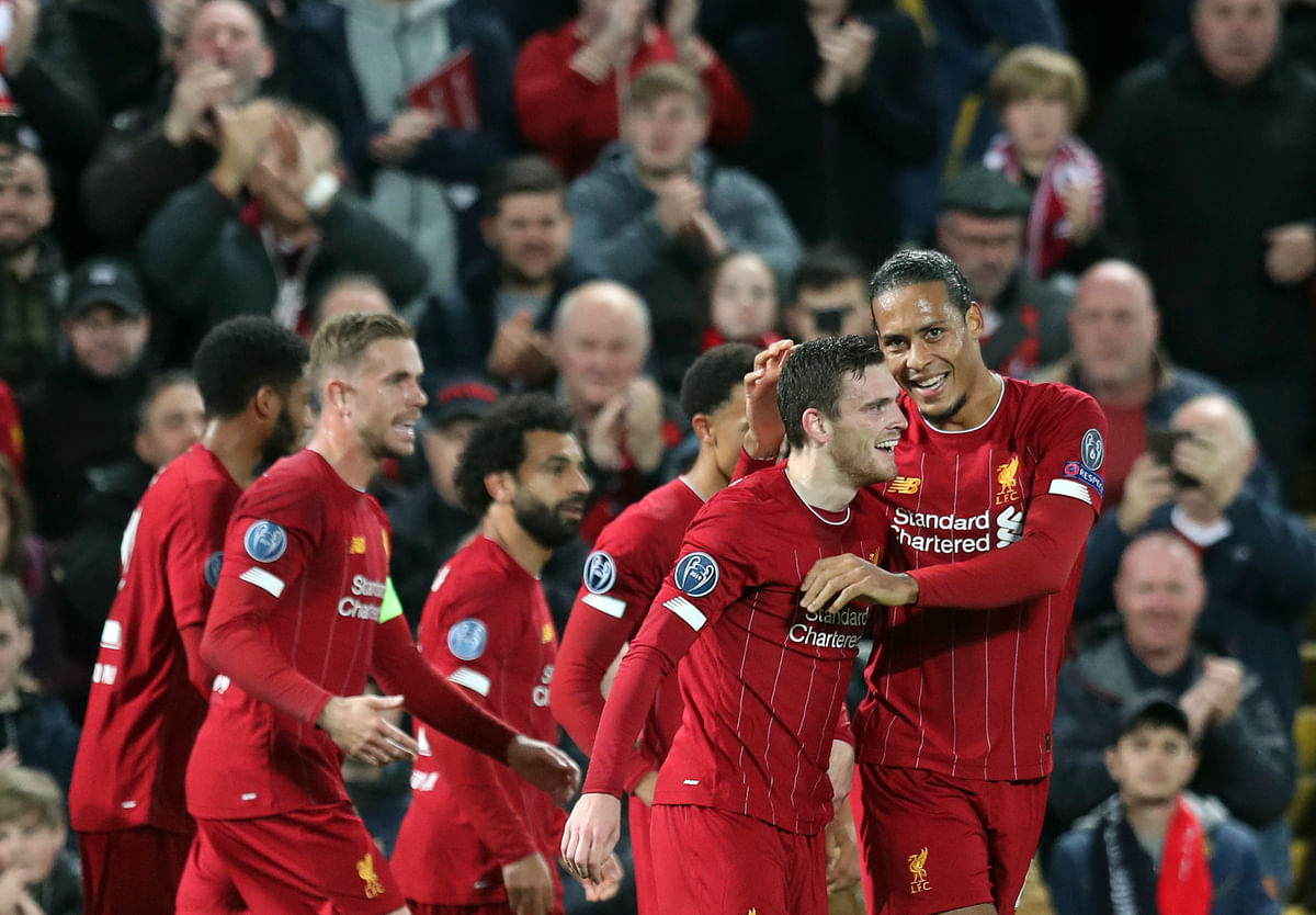 Liverpool's Andrew Robertson, second right, celebrates with teammates after scoring his side's second goal during the Champions League group E soccer match.