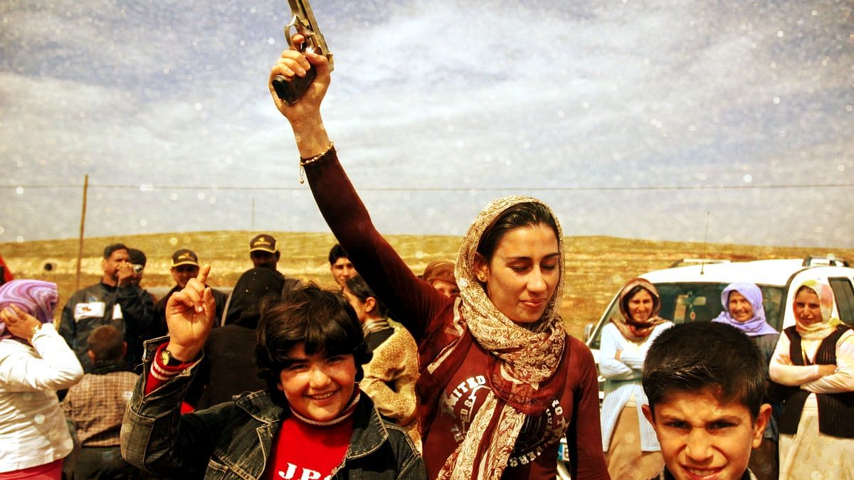 At a Kurdish wedding, men, women & children firing in the air with an arsenal of 12-bore shotguns and pistols. Image used for representational purposes.