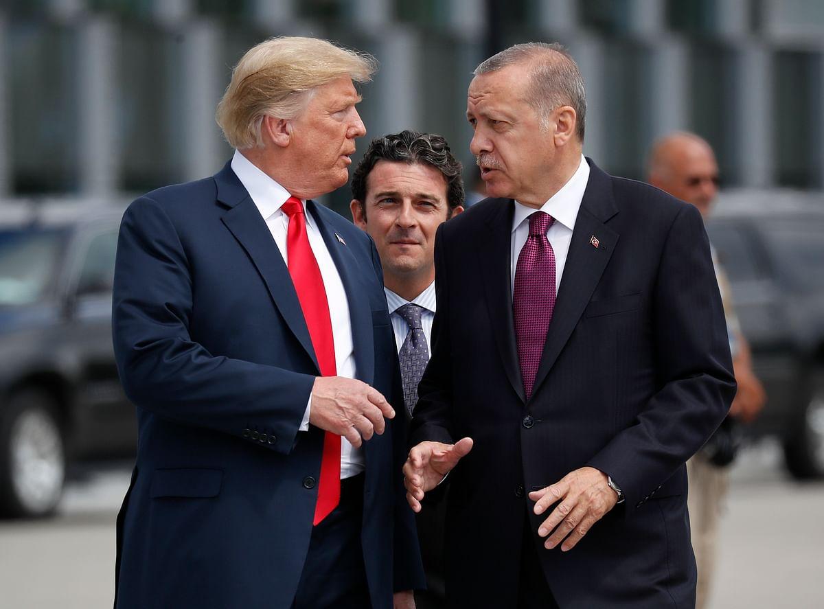 President Donald Trump, left, talks to Turkey's President Recep Tayyip Erdogan.