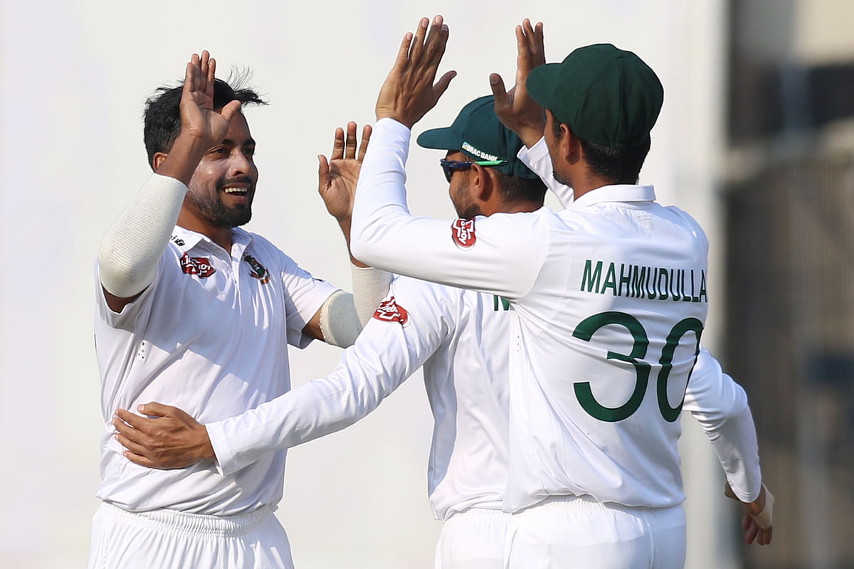 Abu Jayed of Bangladesh celebrates the wicket of Rohit Sharma of India during day one of the the 1st Test match between India and Bangladesh.