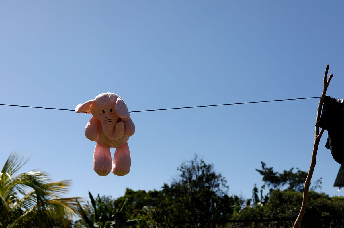 This 23 August 2019, photo shows a stuffed animal hanging to dry at the Comayagua, Honduran home of a 3-year-old who was separated from her father when they tried to seek asylum at the US southern border. She was sexually abused in US foster care, according to court records. She was later deported and arrived back in Honduras withdrawn, anxious and angry.