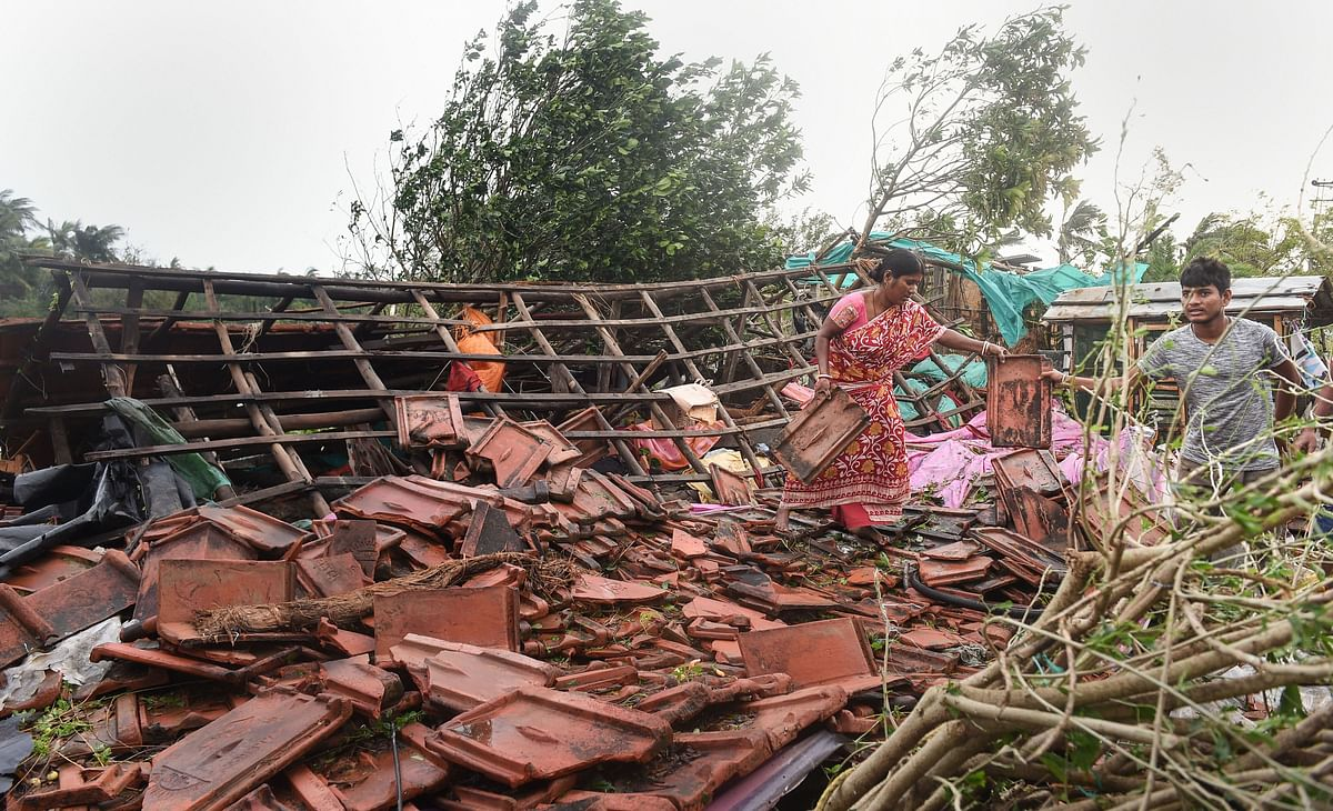 Bakkhali: A woman stands on the remnants of her house in the aftermath of the cyclone.