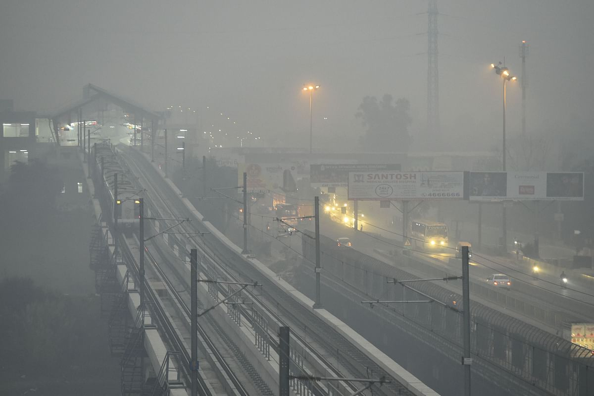 Delhi metro running amid dense haze and low visibility, in Ghaziabad on Thursday 31 October.