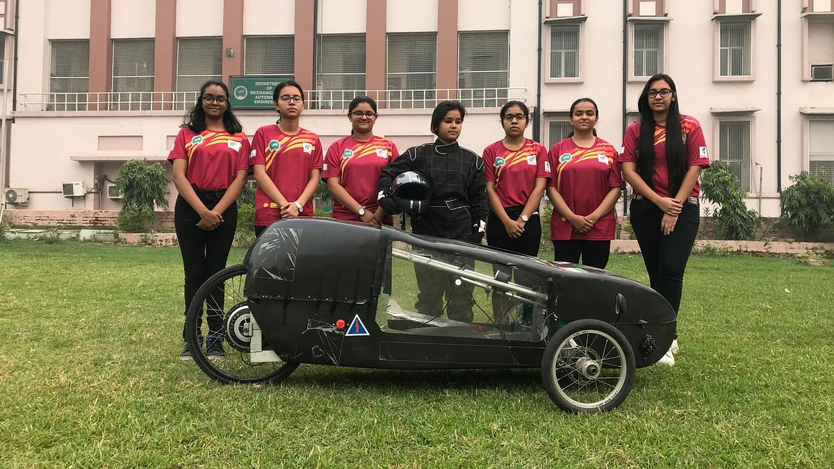 Students of Indira Gandhi Delhi Technical University for Women with their electric car that claims to do 250 Km on one unit of electricity.