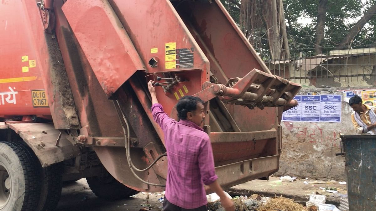 A worker clears garbage inRK Puram area.