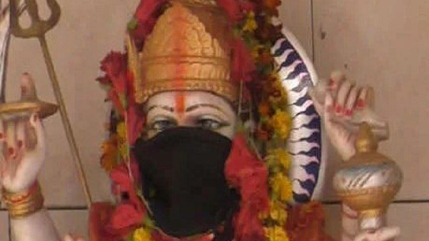 The face of an idol covered with mask at a temple n Varanasi.
