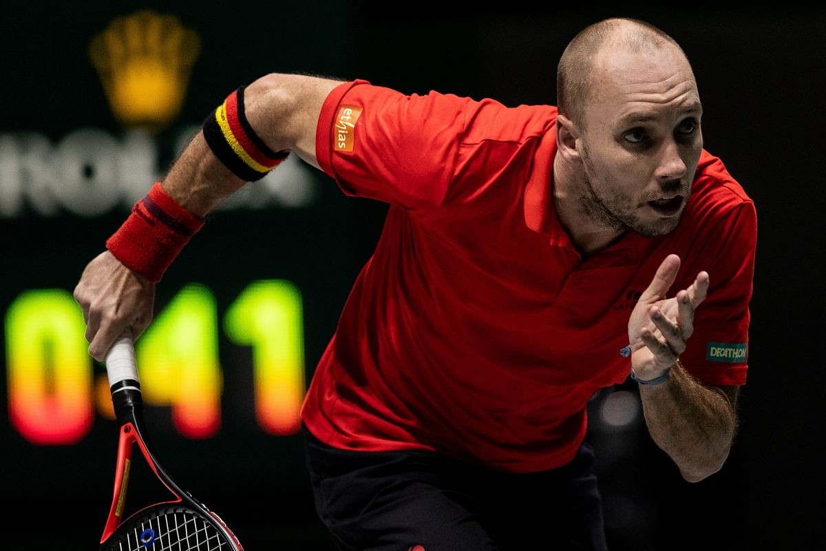 Belgium's Steve Darcis runs for the ball during the Davis Cup tennis match against Colombia's Santiago Giraldo in Madrid.