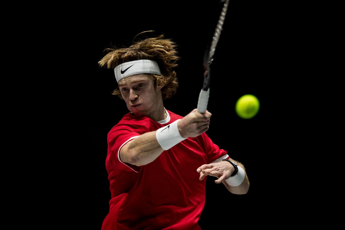 Russia's Andrey Rublev returns the ball to Croatia's Borna Gojo during their Davis Cup tennis match in Madrid, Spain.