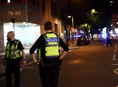 LONDON, June 4, 2017 (Xinhua) -- Police stand guard near the London Bridge in London, Britain, on June 3, 2017. Unidentified attackers drove a van into pedestrians on London Bridge Saturday night and stabbed people in the nearby Borough Market area. British authorities have classified the incidents as terrorist attacks. (Xinhua/Xu Hui/IANS)
