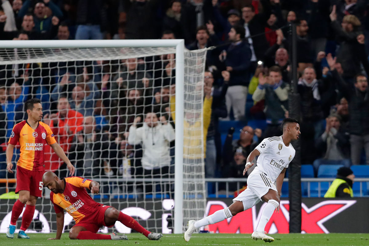 Real Madrid's Rodrygo reacts after scoring the opening goal during a Champions League group A game between Real Madrid and Galatasaray at the Santiago Bernabeu stadium in Madrid.