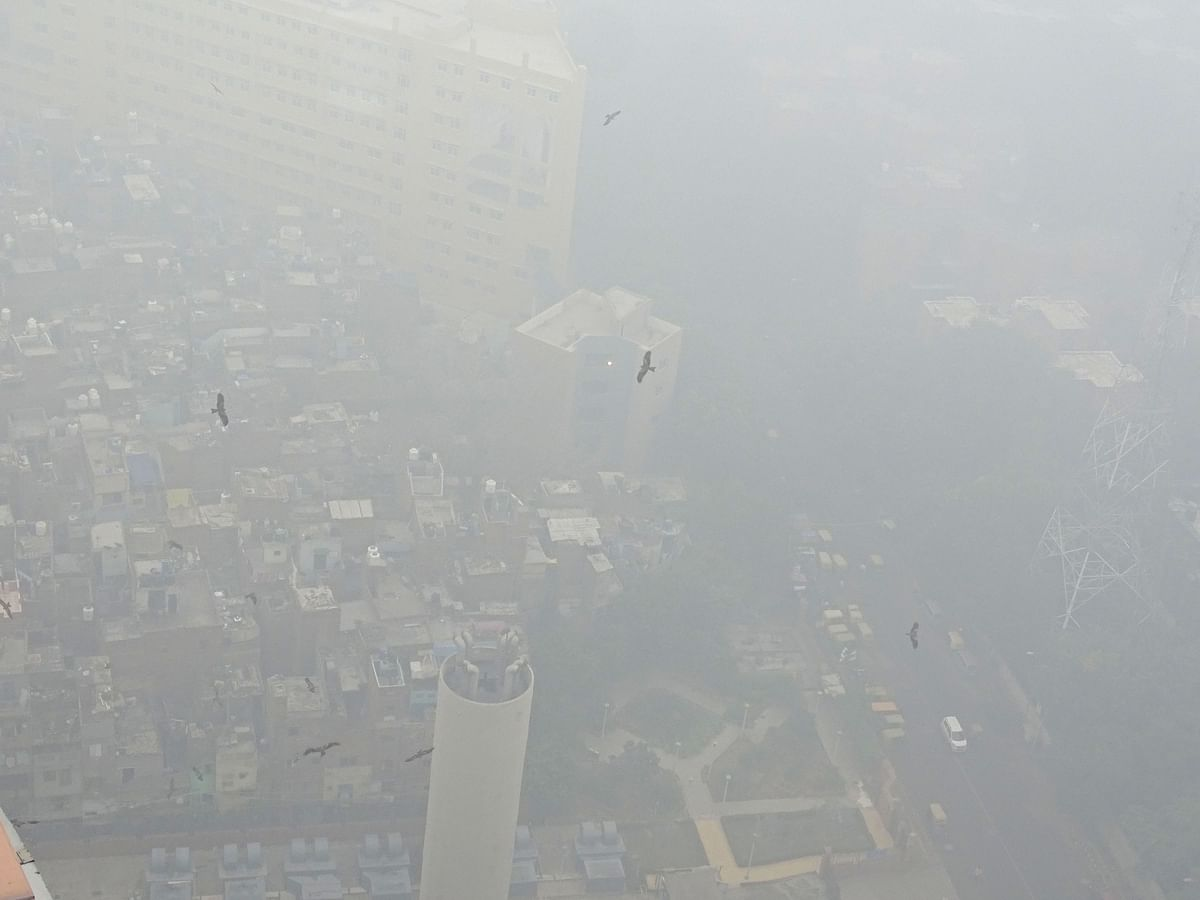 An aerial view of the capital covered in smog. The city was enveloped in a thick layer of smog on  the minimum temperature settling at 18.7 degrees Celsius, four notches above the season's average.